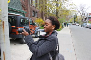 photo of Flora with a camera on the street