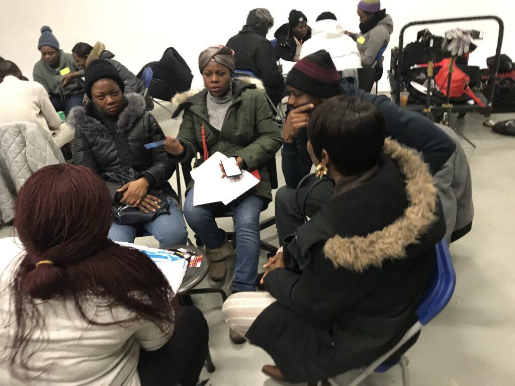photo of meeting of LGBTQ asylum seekers